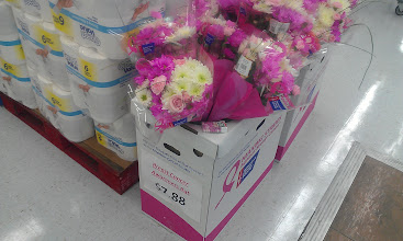 Photo: Walmart is also (slightly) prepared for Breast Cancer Awareness Month with these bouquets just inside the door. I think the price is a little high actually and I wish they had put more emphasis on such an important cause.
