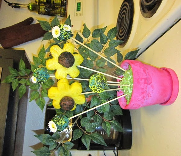 Assembly Time! Take the flowes and add the chocolate balls to the middle to...