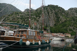 Photo: Port of Kotor, with steep in background which is surrounded by the old fort walls