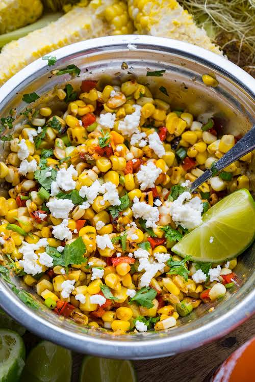 "Sriracha Lime Corn Salad""Summer is the season for salads and I am..."