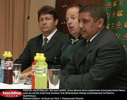 Top coaches: Jake White, centre, with assistant coaches Gert Smal, left, and Allister Coetzee face the media in Perth in 2004. Picture: GALLO IMAGES