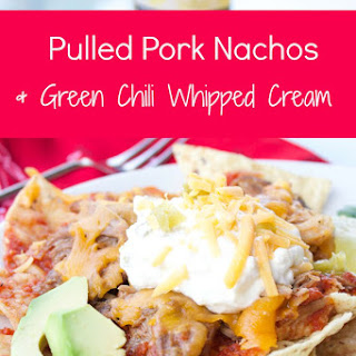 Pulled Pork Nachos With Green Chili Whipped Cream.