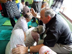 Photo: Praying for the sick at Pastor Ishwar's church