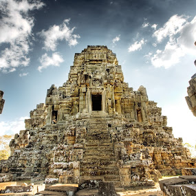 Cambodian temple ruins by Ben Heys - Travel Locations Landmarks ( tomb, old, brick, vivid, buddhist, stone, angkor, architecture, travel, artwork, asian, anchor, religion, buddhism, stairs, sky, ancient, nature, cambodian, asia, monument, ruins, cambodia, building, structure, art, carving, up, temple, famous landmarks, outdoor, antique, natural, religious, outside )