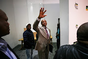 Former North West premier, Supra Mahumapelo, waves goodbye after announcing he would be taking 'early retirement' at a press conference at Luthuli House in Johannesburg on May 23 2018.