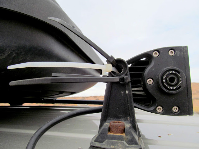 Zip ties holding the light bar on the Jeep
