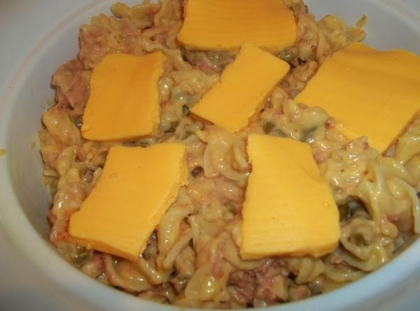 Place slices of cheese - or break cheese into pieces and evenly place on...
