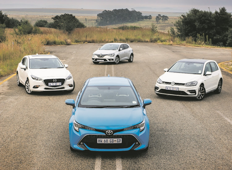 Clockwise from the front: Toyota Corolla, Mazda 3, Renault Megane and Volkswagen Golf.