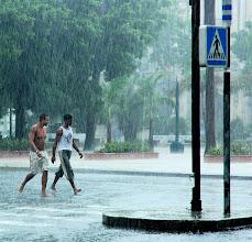 Photo: caught in the rain, havana. Tracey Eaton photo.