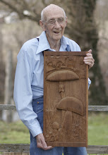 Photo: Dick Grimm holding one of his excellent wood carvings-2013. Photography by Alan McClelland.