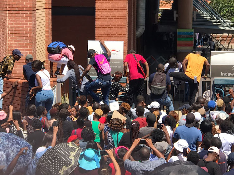 UNISA is in a meeting with Sasco in an effort to resolve issues that led to chaos at the university's Sunnyside campus on Monday morning.