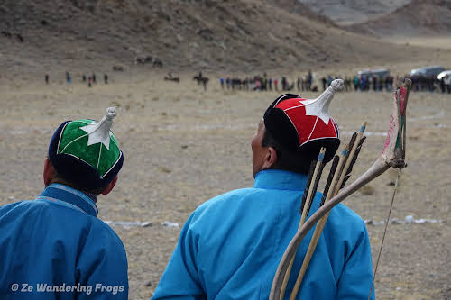 Mongolia. Golden Eagle Festival Olgii. Archers watching an eagle in the sky