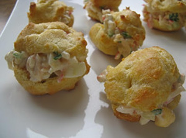 Slice each puff in half and fill with the crab mixture.