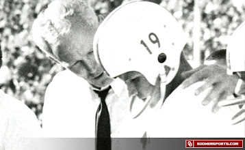Photo: Wilkinson consoling a player on the sidelines. The player and date are unknown.