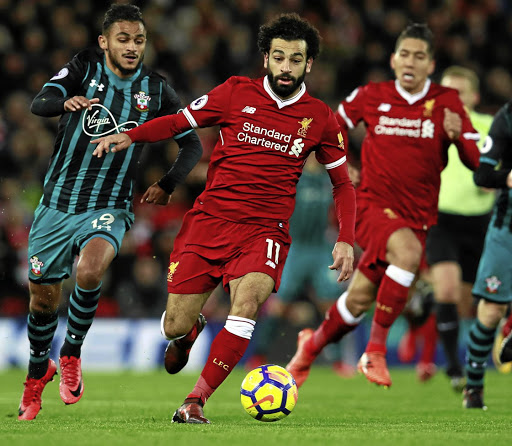 On a roll: Liverpool's Mohamed Salah, centre, has scored 14 goals in all competitions this season and would relish scoring against his old club Chelsea. Picture: REUTERS