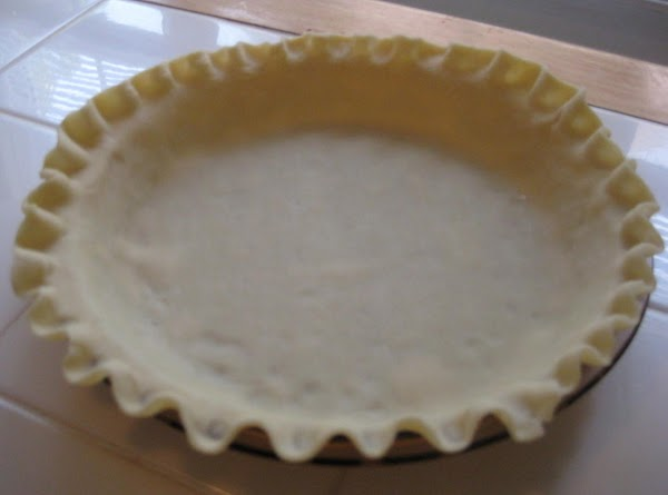 Preheat oven to 425°F. Roll a pastry round into a 12-in. circle. (Use a...