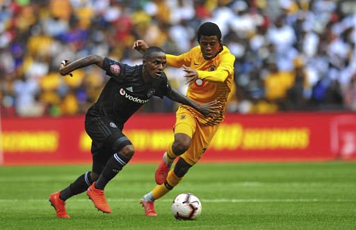 Happy Mashiane of Kaizer Chiefs challenges Thembinkosi Lorch of Orlando Pirates during the Absa Premiership match between Kaizer Chiefs and Orlando Pirates at FNB Stadium yesterday.