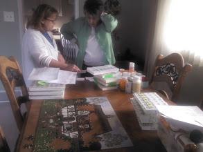 Photo: Marilyn, Barb sorting meds