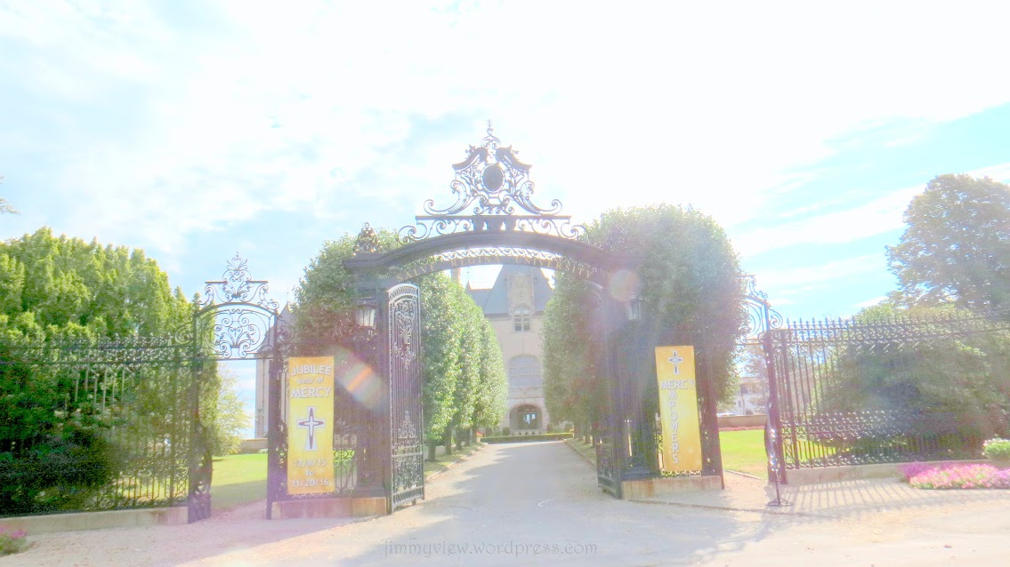 Ochre Court. Pardon the overexposed picture as the sun was glaring right into my lens at this hour. I wanted to get the name of the university on the gate.