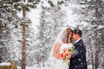 Photo: It was a snowy wonderland in Estes Park, CO this past weekend.  Jessica and Luis tied the knot and they braved the cold and snow for some dreamy photos in the pine trees.