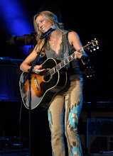 Photo: CLARKSTON, MI - AUGUST 12: Sheryl Crow performs during the Palace Sports and Entertainment's Come Together Celebration concert at the DTE Energy Music Theater on August 12, 2012 in Clarkston, Michigan. (Photo by Paul Warner/Getty Images)