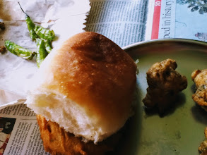 Photo: Wada Pav, the Indian burger. Around 5 Rupees on the street, there are always crowds gathering around popular stalls. The patty is croquette made of potato, karipatta (curry leaves) and other savoury ingredients. I can never forget the sensation when I experienced a Wada Pav for the first time in my life. (Reference: http://www.vegrecipesofindia.com/poori-bhaji/) 23rd December updated -http://jp.asksiddhi.in/daily_detail.php?id=401