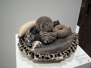 "Photo: Ceramic rattles and bowl, by Kelly Jean Ohl. Exhibition of ceramic musical instruments at The Bascom Arts Center in Highlands, NC. The exhibit, curated by Barry Hall and Brian Ransom, features musical instruments created by ceramic artists from around the world, as featured in the book ""From Mud to Music"" by Barry Hall."