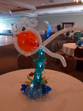 Photo: Under the Sea swimming centerpiece with sparkle lights for Grand Haven High School's 2011 Prom at Trillium Banquet Hall, Spring Lake, Michigan Beautiful place!