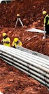 Thumbnail of men in yellow protective gear working on pipeline