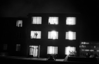 Photo: Students watch safely from their dorm rooms as the guard moves onto the campus.