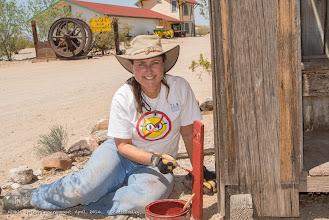 Photo: Debbie Miller-Marschke adding new paint to the Goffs Cultural Center guide posts. (Scott Braley)