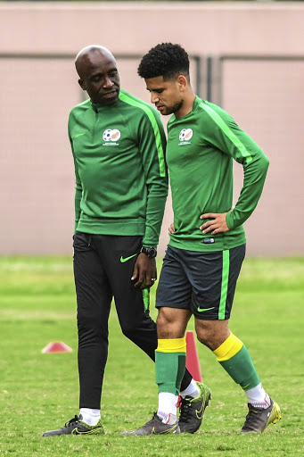 Coach David Notoane and Keagan Dolly during Bafana training session at Sugar Ray Xulu Stadium in Durban last week.
