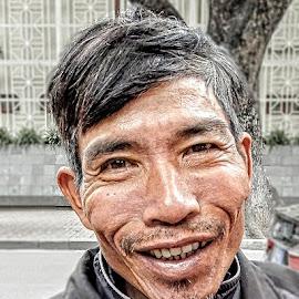 Man on the Street by Richard Michael Lingo - People Street & Candids ( street, vietnam, hair, people, man,  )