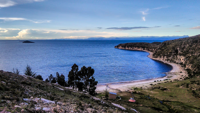 watching the azure blue water of lake titicaca from isla del sol while traveling in bolivia
