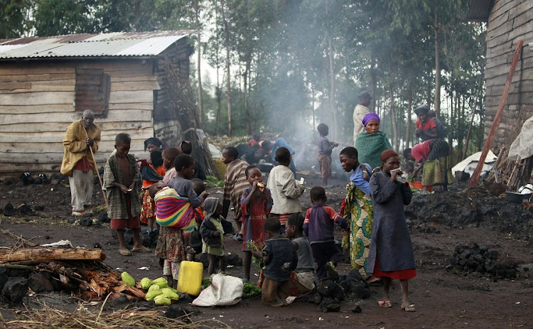 Civilians displaced by fighting near Goma in the eastern Democratic Republic of Congo. The country is four times the size of France but has fewer paved roads than Luxembourg. Picture: REUTERS/THOMAS MUKOYA