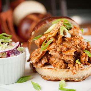 Texas-Style BBQ Pulled Chicken Sandwich On a Pretzel Bun with Green Onion Slaw
