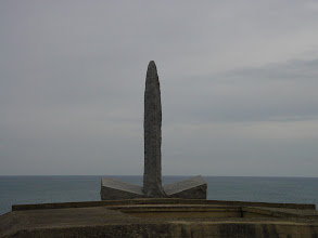 Photo: The monument, at the cliff's edge (and blocked from closer approach due to erosion), commemorates the 225 Rangers who began the battle – with only 90 remaining at the end.