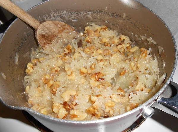 Remove from heat and stir in coconut, nuts, and vanilla. Pour over cake and...