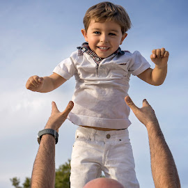 Up you go! by Laura Prieto - Babies & Children Children Candids ( play, sky, fly, kid, boy, child, jump,  )