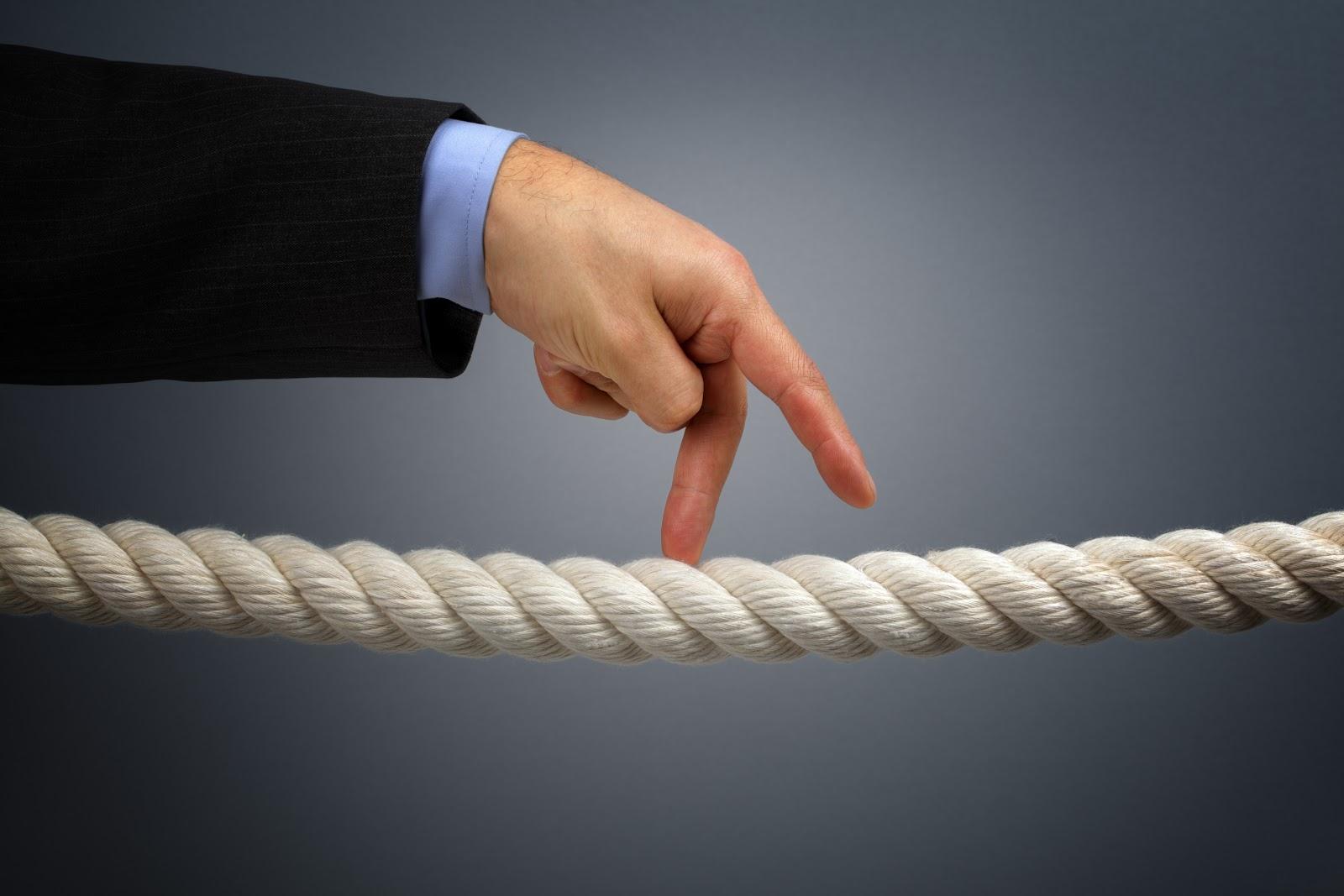 Fingers walking across a tightrope