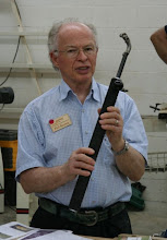 Photo: Phil Brown shows a Rolly Munro hollowing tool, from the shop of the late Al Dickenson, that will be auctioned next month. Alan Hollar praised this tool highly.