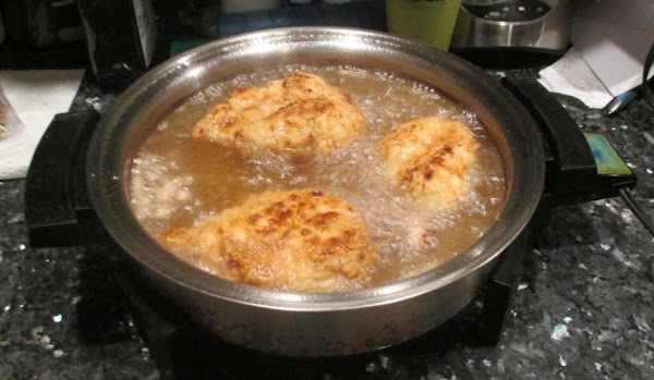 Place the chicken pieces in the fryer for 12-14 minutes or deep skillet for...