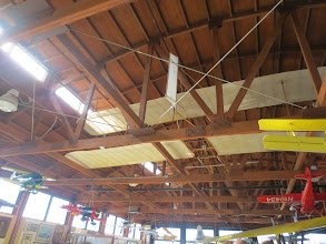 Photo: The original canvas of the Wright Brothers' airplane, stretched across a re-creation scaffolding