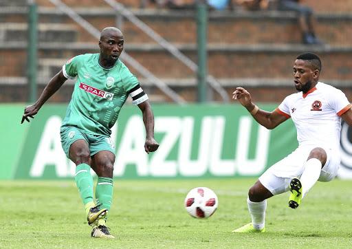 70a197e7a Siyabonga Nomvethe of AmaZulu takes on Polokwane City s Edgar Manaka during  their Premiership match on Sunday