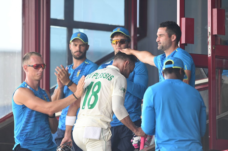 team mate clap as Faf du Plessis of the Proteas enters the dressing room during day 3 of the 1st Betway Test (WTC) match between South Africa and Sri Lanka at SuperSport Park on December 28, 2020 in Pretoria, South Africa.