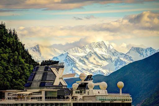 Celebrity-Alaska-Mendenhall-Glacier - The top deck of Celebrity Infinity seen against the Mendenhall Glacier in Alaska.