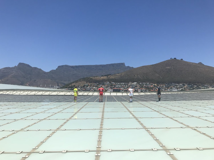 Some of the captains of the teams who are going to participate in the World Sevens Cape Town leg in South Africa posing for photo on top of the Cape Town Stadium, which is near world heritage site the Table Mountain.