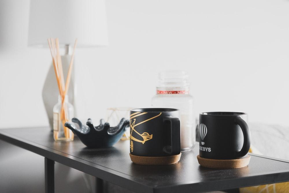 two black ceramic cups