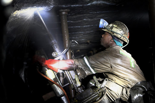 A drill operator working underground at Lonmin's western platinum mine at Marikana