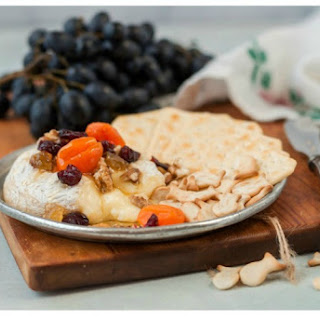 Baked Brie with Dried Cherries, Apricots and Nuts.